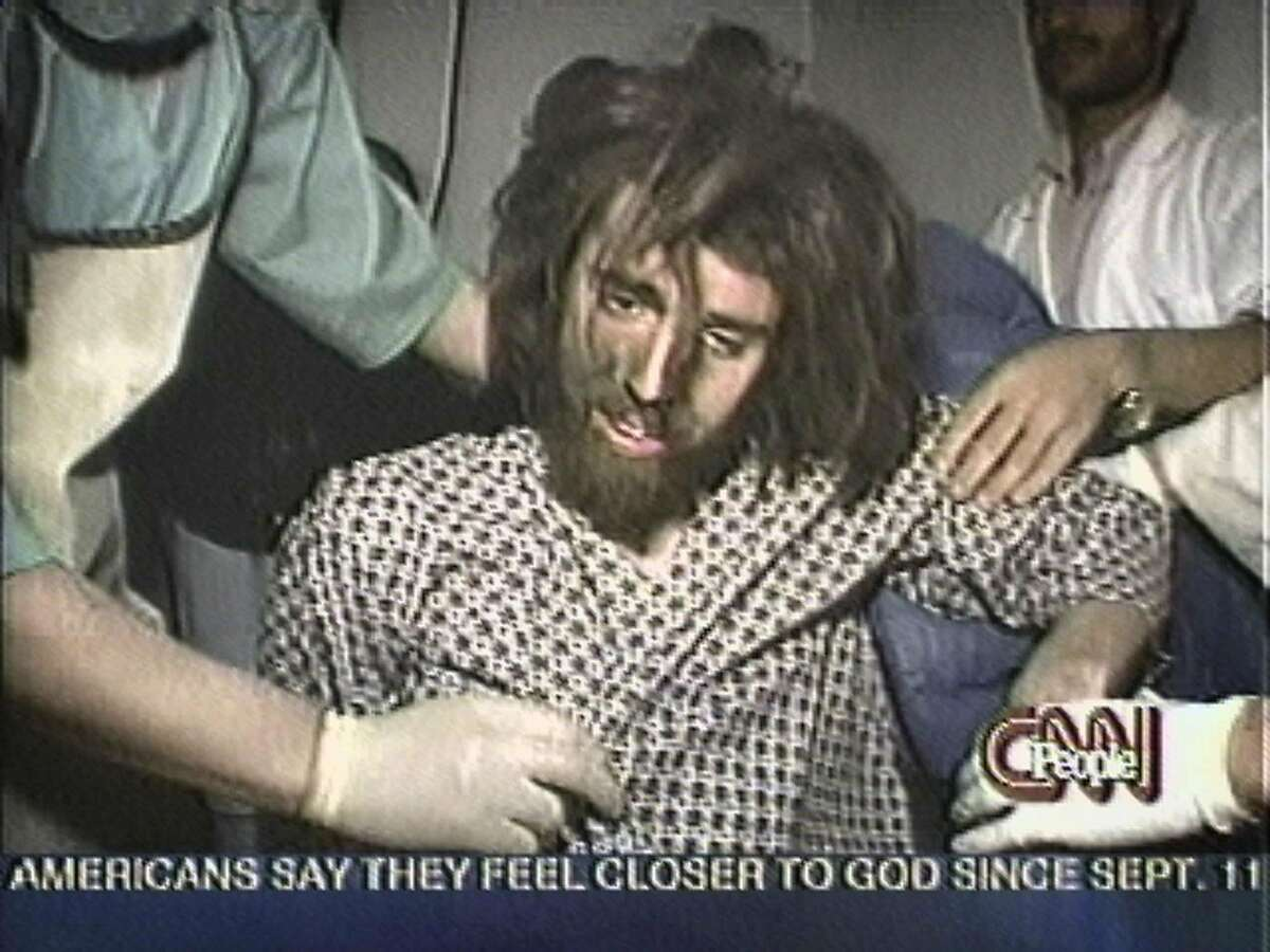 """** FILE ** This image from the CNN show"""" People in the News"""" shows a bearded and bedraggled John Walker Lindh being interviewed in Afghanistan Dec. 2, 2001. Lindh, now clean shaven with short hair, has admitted his association with the Taliban and may face 20 years in jail; another step in his journey that began with visits to evangelical San Francisco mosques when he was 16 years old. (AP Photo/CNN)"""