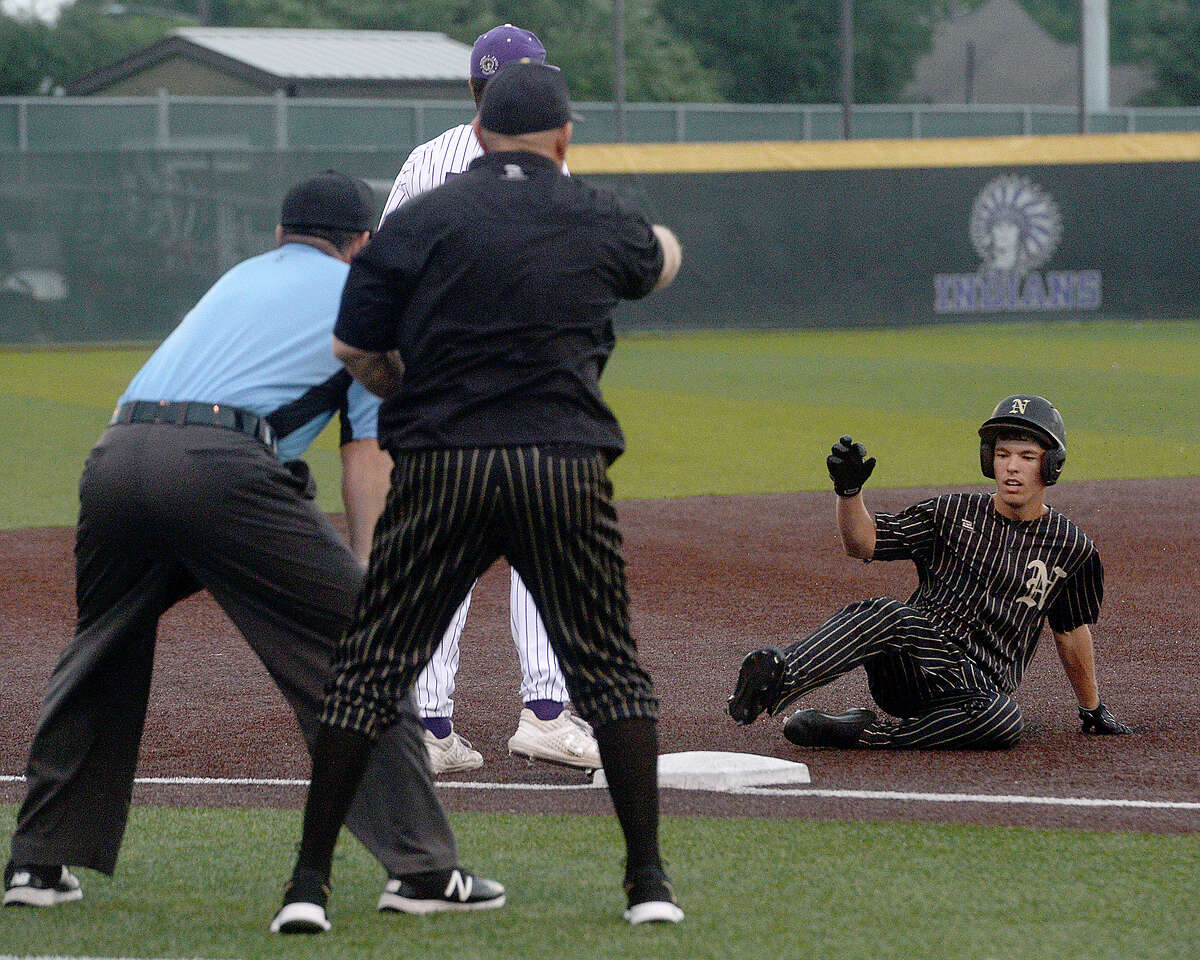 Nederland's Wade Butler slides into third after being in the first run for the bulldogs on his triple against Port Neches - Groves during game 2 of their quarterfinal match-up Friday night at PNG. Photo taken Friday, May 17, 2019 Kim Brent/The Enterprise