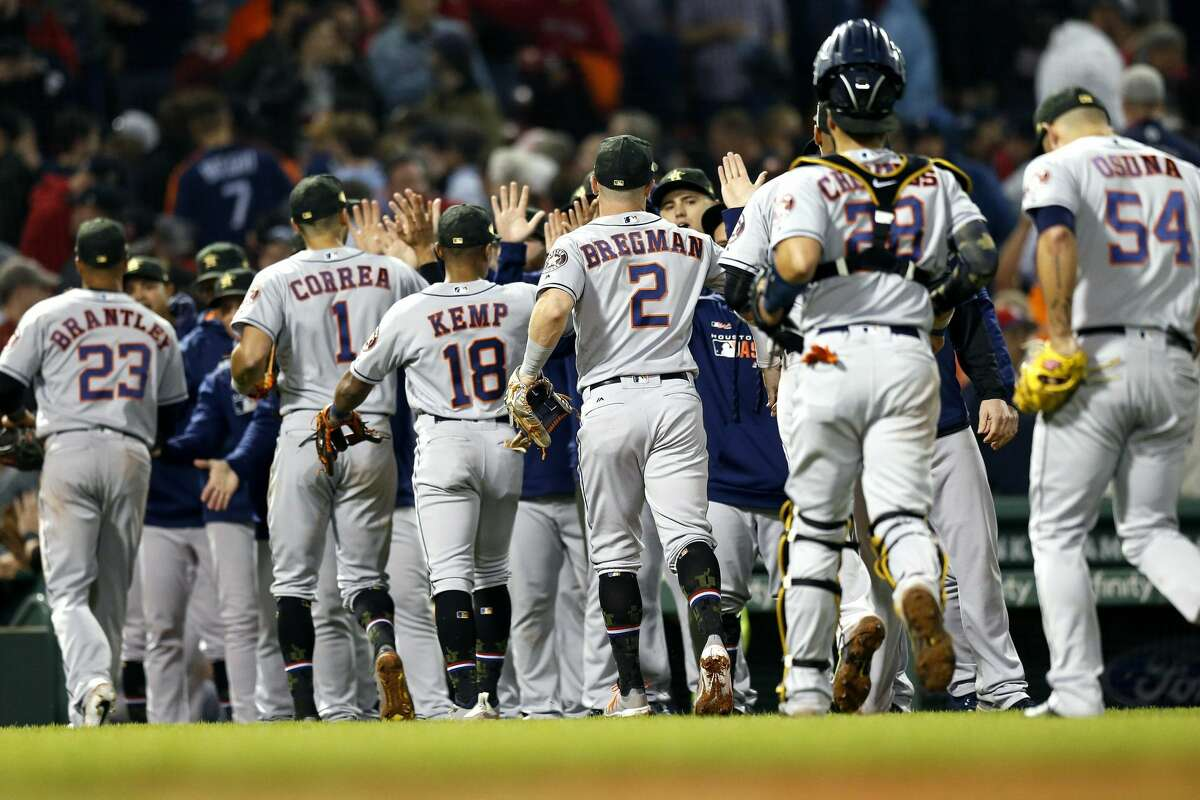 The Houston Astros celebrate after defeating the Boston Red Sox during a baseball game in Boston, Friday, May 17, 2019. (AP Photo/Michael Dwyer)