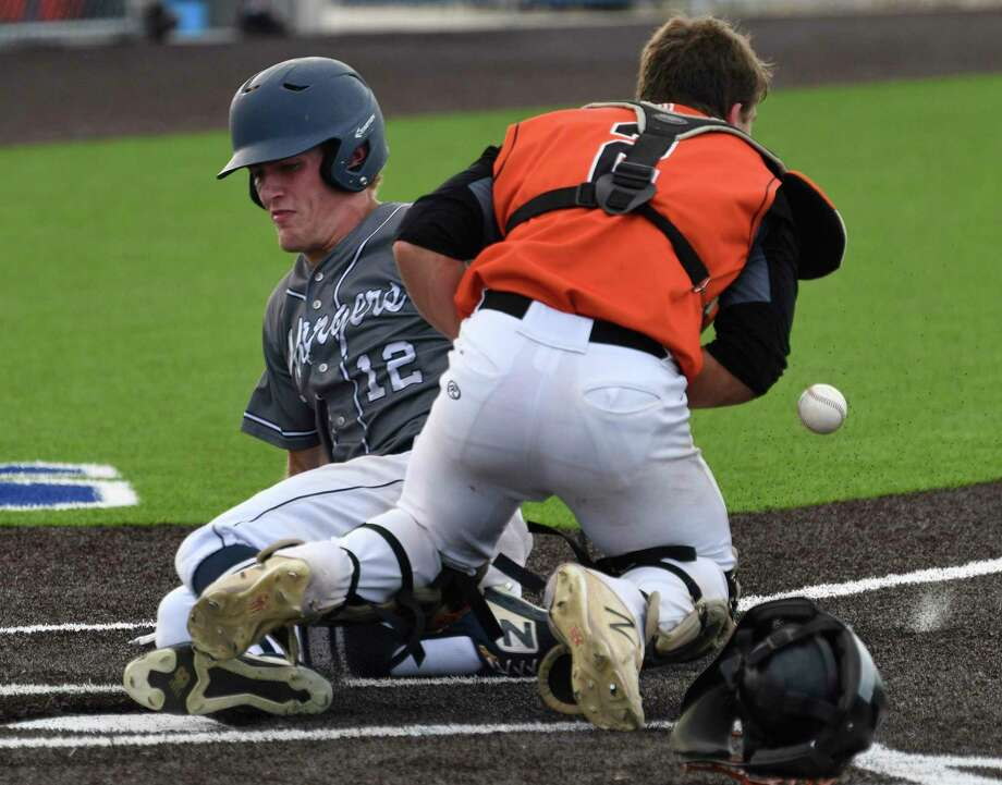 Born Champions's Bowen Fjord (12) slides safely home as Medina Valley catcher Grant Snider is unable to handle the throw during Game 2 of the best of three Class 5A baseball playoff series on Friday, May 17, 2019. Photo: Billy Calzada, Staff / Staff Photographer / Billy Calzada