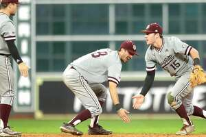 Texas Aggies infielder Bryce Blaum (15) celebrates with infielder Braden Shewmake (8) and infielder Ty Coleman (1) after the Texas Aggies defeated the Houston Cougars in the 2019 Shriners College Classic at Minute Maid Park, Sunday, March 3, 2019, in Houston.