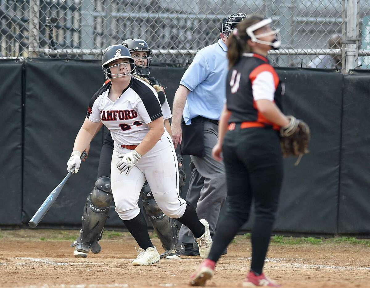Stamford's Amy Covino follows a second inning home run against Ridgfield pitcher Skylar Arent in an FCIAC quarterfinal softball game at Stamford High on Friday. Stamford won, 10-7.