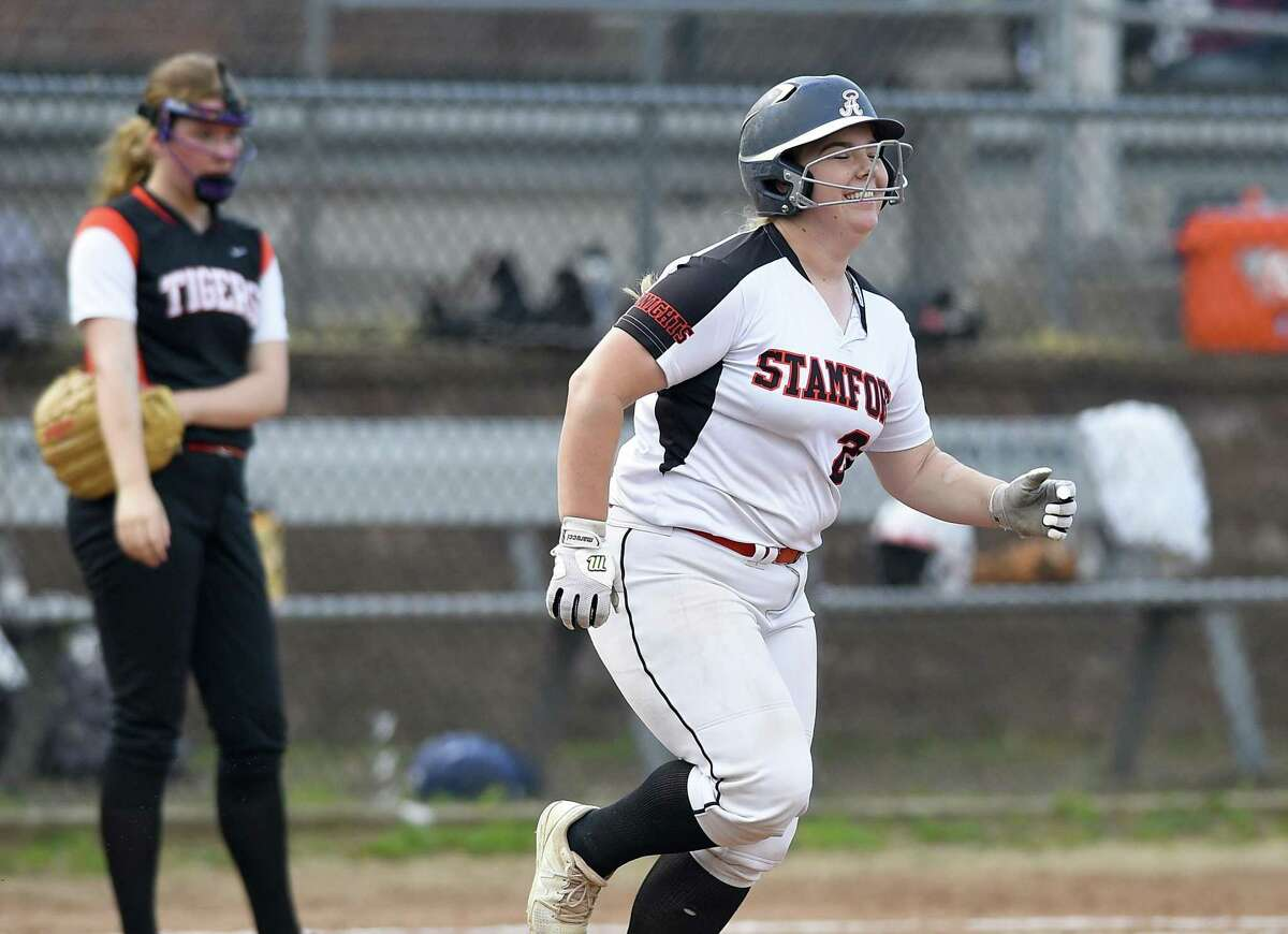 Stamford's Amy Covino (24) rounds the bases following a home run.