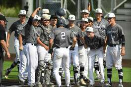 Luke Boyers (2) of Boerne Champion is greeted at home plate by teammates after hitting a first-inning home run against Medina Valley during Game 2 of the best of three Class 5A baseball playoff series on Friday, May 17, 2019.