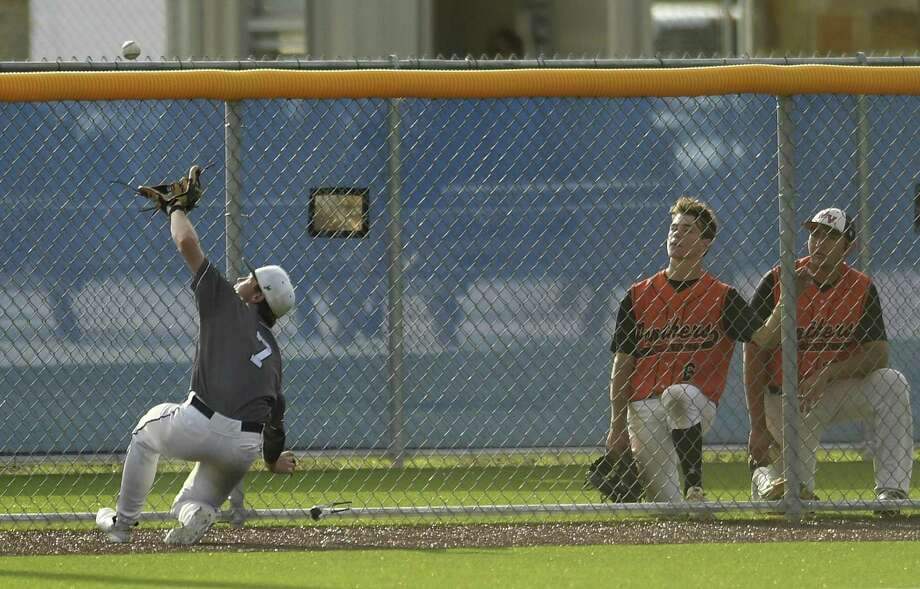 Boerne Champion shortstop Michael Gresham (7) makes a sliding catch of a foul pop fly during Game 2 of the best of three Class 5A baseball playoff series against Medina Valley on Friday, May 17, 2019. Photo: Billy Calzada, Staff / Staff Photographer / Billy Calzada