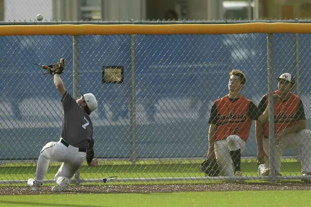 Boerne Champion shortstop Michael Gresham (7) makes a sliding catch of a foul pop fly during Game 2 of the best of three Class 5A baseball playoff series against Medina Valley on Friday, May 17, 2019.