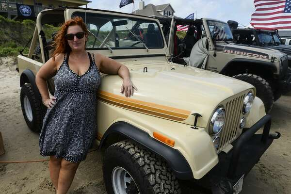 Fara Snowden poses with her Jeep during the annual Go Topless Jeep weekend in Crystal Beach on Friday. Photo taken on Friday, 05/17/19. Ryan Welch/The Enterprise