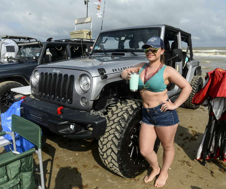 People pose with their Jeeps during the annual Go Topless Jeep weekend in Crystal Beach on Friday. Photo taken on Friday, 05/17/19. Ryan Welch/The Enterprise Photo: Ryan Welch/The Enterprise