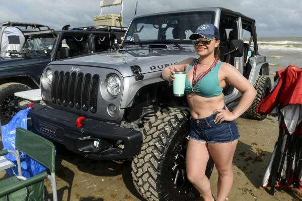 People pose with their Jeeps during the annual Go Topless Jeep weekend in Crystal Beach on Friday. Photo taken on Friday, 05/17/19. Ryan Welch/The Enterprise