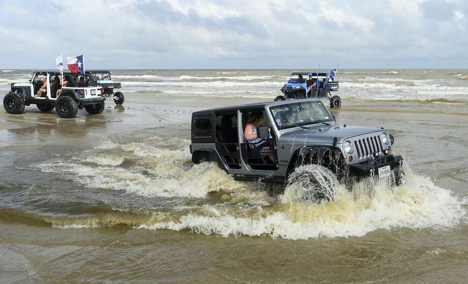 People and their Jeeps fill the beach during the annual Go Topless Jeep weekend in Crystal Beach on Friday. Photo taken on Friday, 05/17/19. Ryan Welch/The Enterprise Photo: Ryan Welch/The Enterprise