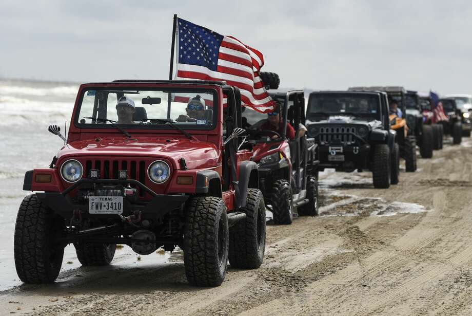 People and their Jeeps fill the beach during the annual Go Topless Jeep weekend in Crystal Beach Photo: Ryan Welch/The Enterprise