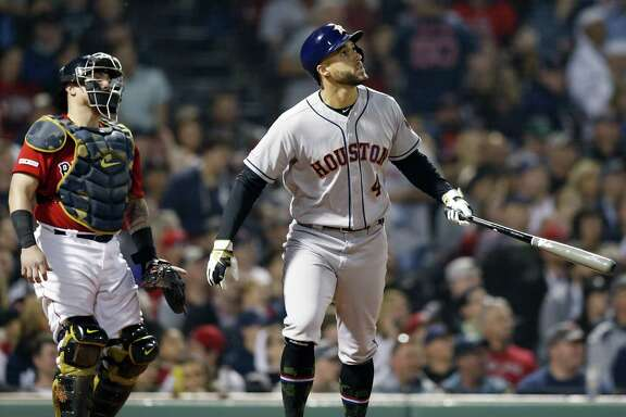 George Springer admires his handiwork after launching a go-ahead, two-run homer in the eighth inning at Fenway Park.
