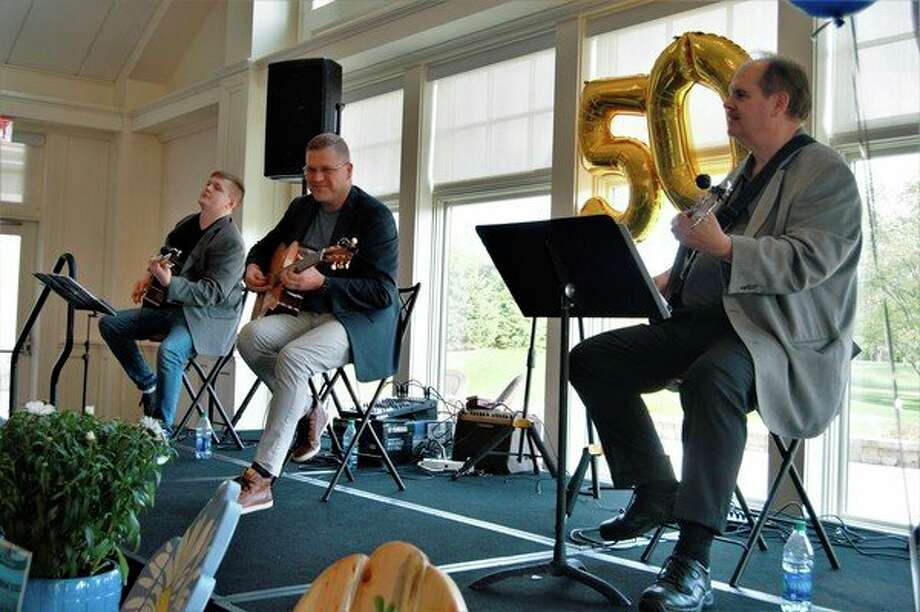 The Jim Pagel Jazz Trio band, consisting of (from left to right) Jason Cox, Jim Pagel and George Puia, carried the night with 'gypsy jazz' at the Home To Stay Housing Assistance Center fundraising event on May 16, 2019 at the Midland Country Club. (Ashley Schafer/ashley.schafer@hearstnp.com)