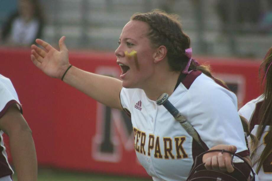 A jubilant Sara Vanderford shouts something to Courtney Plocheck, following Plocheck's three-RBI triple that drove in Vanderford and two other teammates Friday night. Photo: Robert Avery