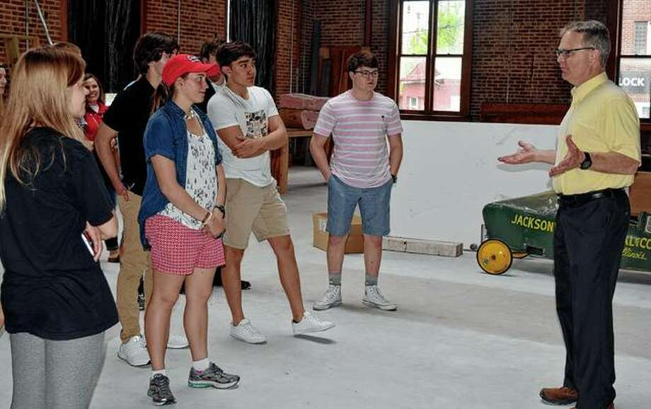 David Blanchette (right) shows students from Jacksonville High School's Advanced Placement history program the interior of Jacksonville's old post office during a tour Friday. The building is being turned into a museum. Photo: Samantha McDaniel-Ogletree | Journal-Courier