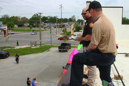 Illinois Department of Corrections officers and members of other area law enforcement agencies participated in the Cop on a Rooftop event to benefit the Law Enforcement Torch Run for Special Olympics. Officers stood on the roof of Dunkin' Donuts in Jacksonville from 5 a.m. to noon Friday.