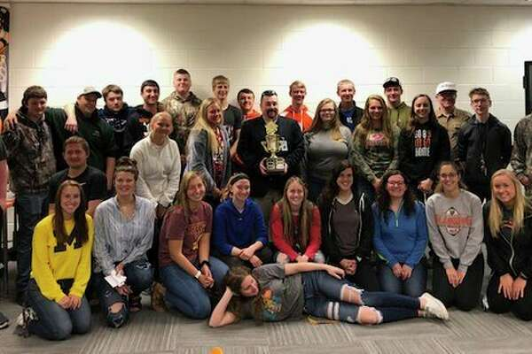 Harbor Beach students are pictured with Brad Merril from Mid Michigan College and their FAFSA Competition trophy. (Submitted Photo)