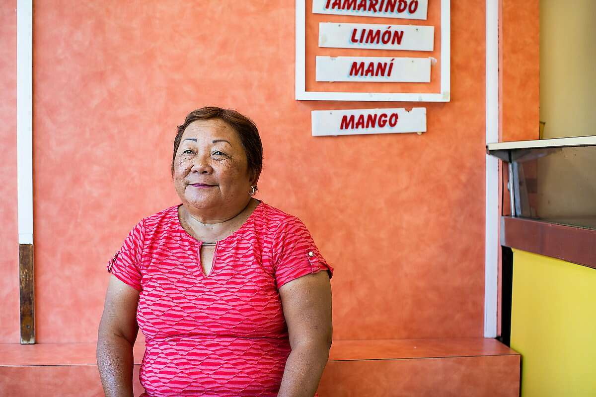 Maria Lao poses for a portrait at her brother's King's Cream store on Marina Street in Ponce, P.R., on April 9, 2019. Lao, who owns the King's Cream store at Vives Street in the same town, is the daughter of Chinese immigrants from Cuba. (Photo by Erika P. Rodriguez)