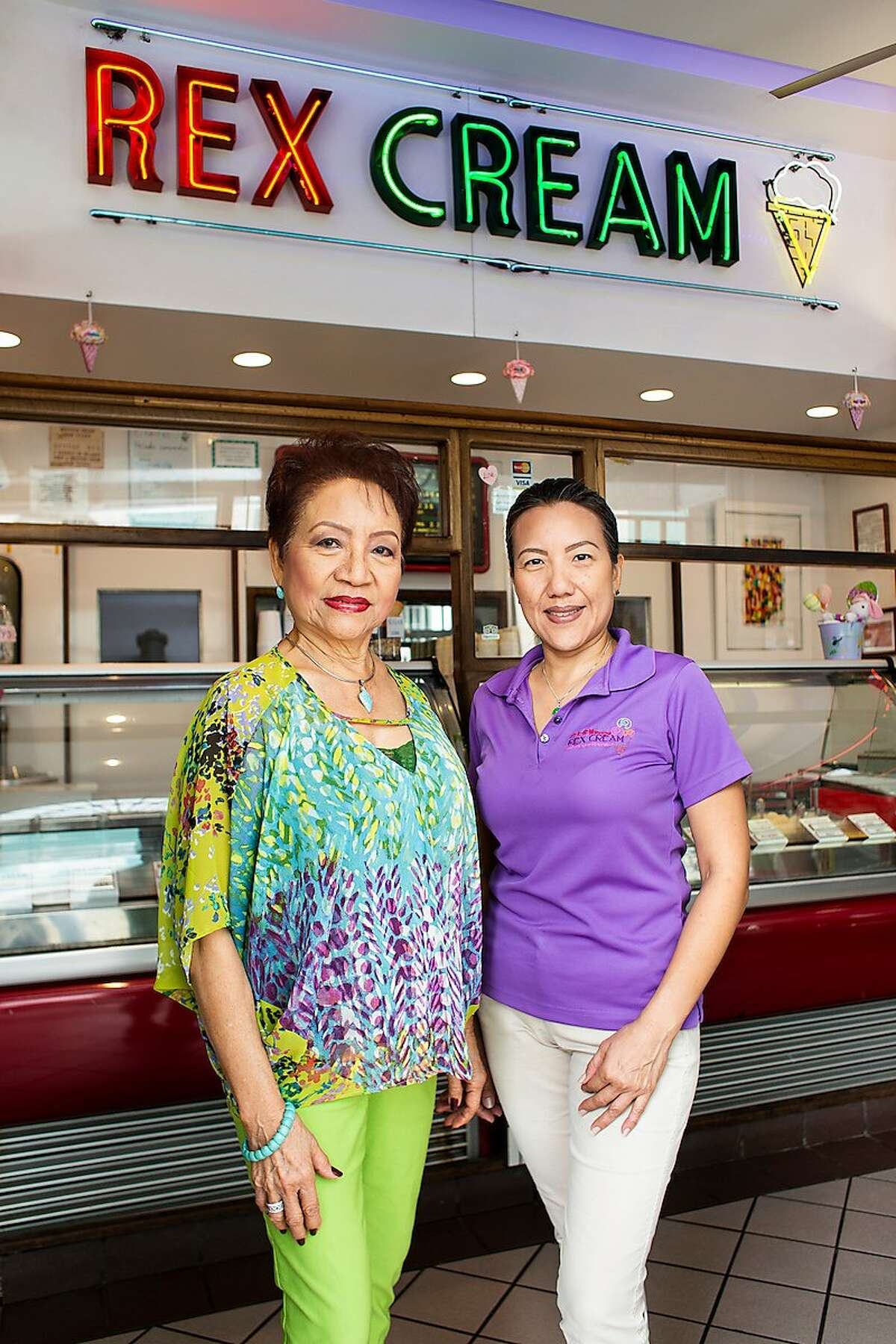 From left, Violeta Chang Louk, 79, poses for a portrait with her daughter Aileen Louk Chang, 47, at the Rex Cream store in Derkes Street in Guayama, P.R., on April 9, 2019. Louk inherited the Chinese ice cream business from her mother, a Chinese immigrant from Cuba. (Photo by Erika P. Rodriguez)