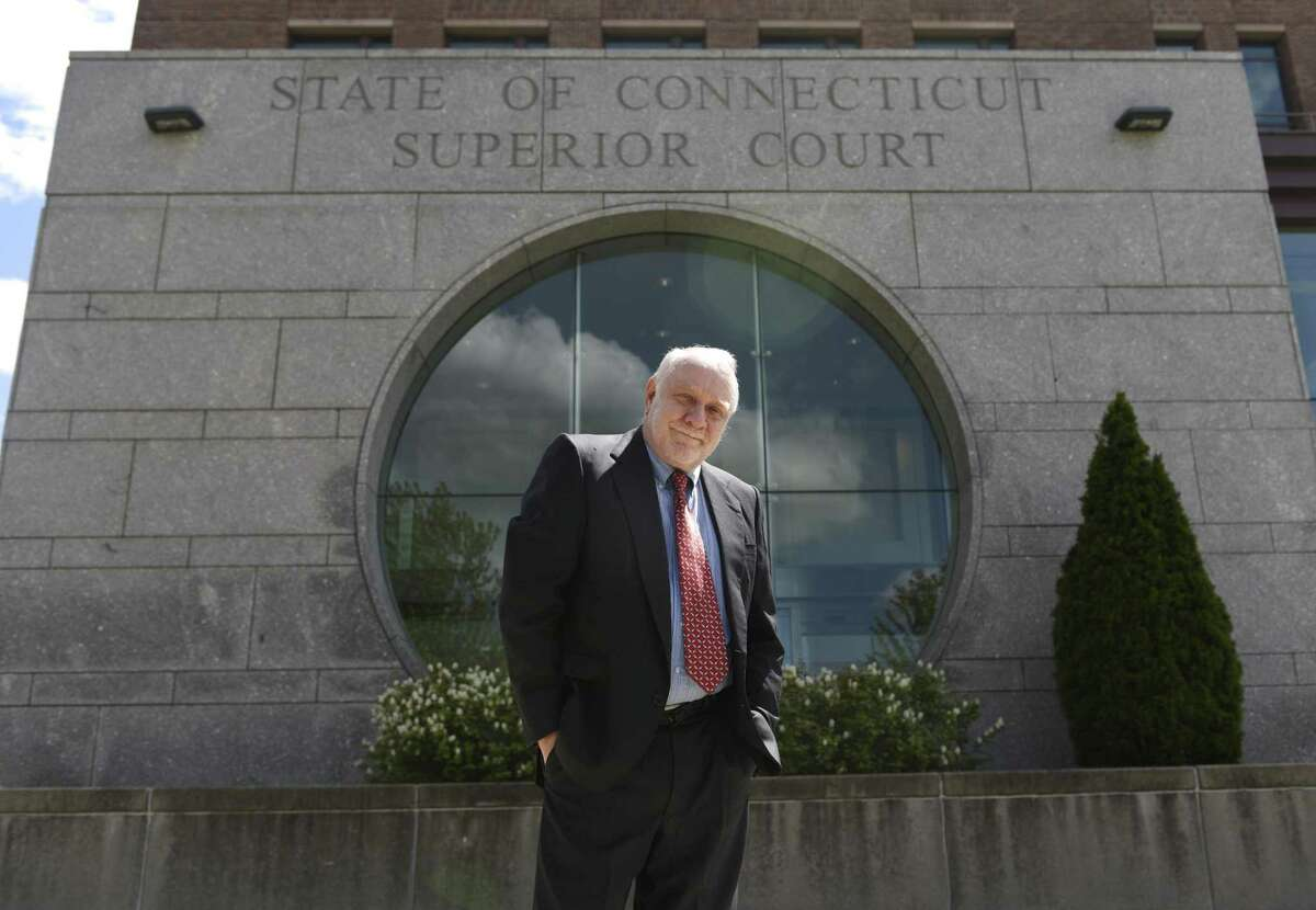 Public defender Howard Ehring poses at the Stamford Superior Court in Stamford on Wednesday. Ehring is the longest serving public defender in Stamford and has worked a number of prominent cases over his 30-plus year career.