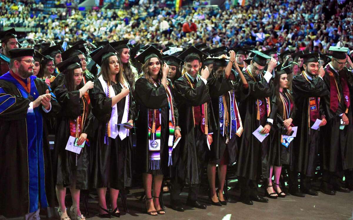 TAMIU graduates flip their tassels during the university's 2019 Spring Commencement ceremony, Wednesday, May 8, 2019, at the Sames Auto Arena.
