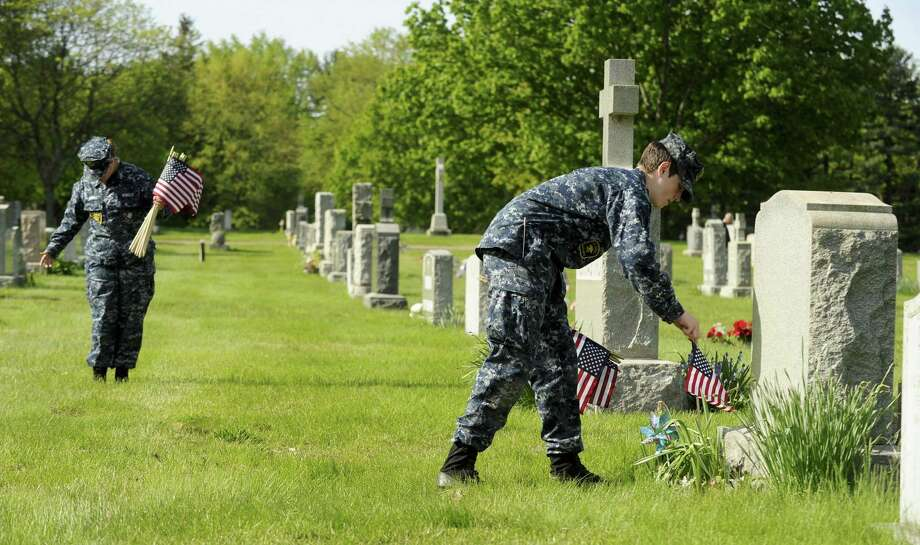 Several members of Springdale Post No. 9617, Veterans of Foreign Wars, and U.S. Naval Sea Cadets join together to place over 4,000 flags on veteran's graves at St. John's Cemetery and throughout Stamford, Connecticut on Saturday, May 18, 2019 in advance of Memorial Day commemorations. Photo: Matthew Brown / Hearst Connecticut Media / Stamford Advocate