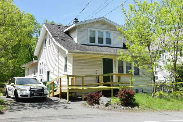 A Guilderland police car sits outside of the home where two people were found dead Friday on Saturday, May 18, 2019 off of Schoolhouse Road in Guilderland, NY. (Phoebe Sheehan/Times Union)