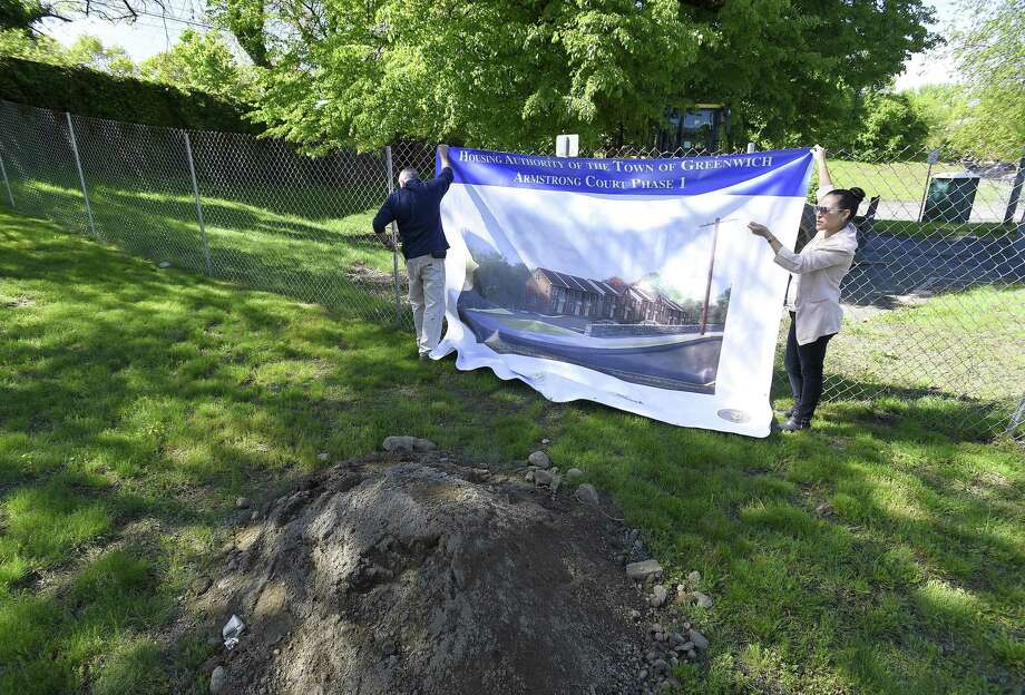 A banner is hung on the site prior to a ground breaking ceremony for 18 new townhomes that will be constructed as part of a phased in construction project at the Greenwich Housing Authority Armstrong Court project in Greenwich, Conn. on May 18, 2019. Photo: Matthew Brown / Hearst Connecticut Media / Stamford Advocate