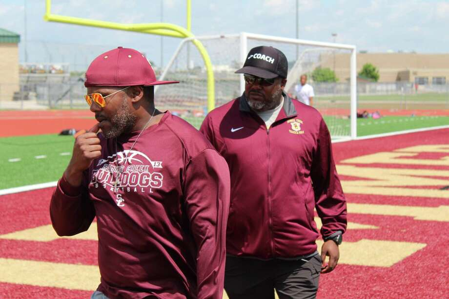 Shelton and Elton Ervin are twin brothers coaching track and field at Summer Creek. Photo: Marcus Gutierrez Staff Photo