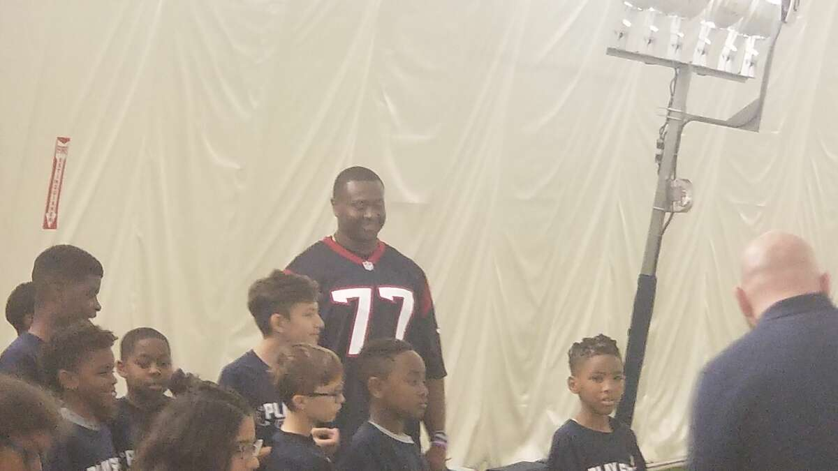 Offensive lineman Martinas Rankin participating in aPlay Safe football clinic.