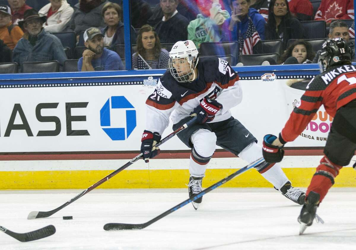 In this Nov. 12, 2017, file photo, the United States' Hilary Knight controls the puck in front of Canada's Meaghan Mikkelson during the second period of the Four Nations Cup championship hockey game in Tampa, Fla.