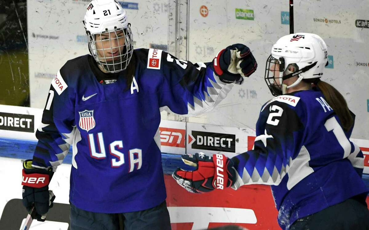 Team USA's Hilary Knight, left, celebrates a goal with Kelly Pannek, who provided the assist, during a IIHF Women's Ice Hockey World Championships semifinal match against Russia, in Espoo, Finland on April 13.