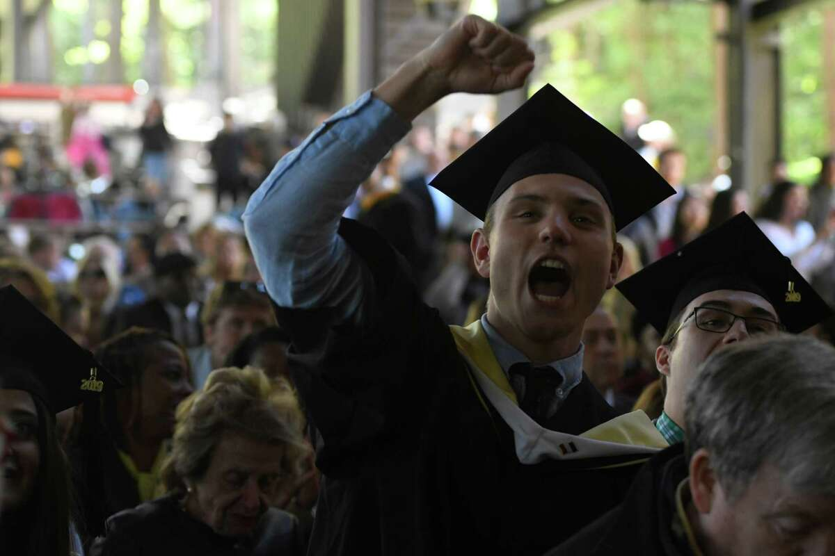 Degree recipient Ted Randall cheers for a fellow graduate receiving a degree on stage at Skidmore graduation ceremony at Saratoga Performing Arts Center in Saratoga Springs, N.Y. on May 18, 2019. (Jenn March, Special to the Times Union)