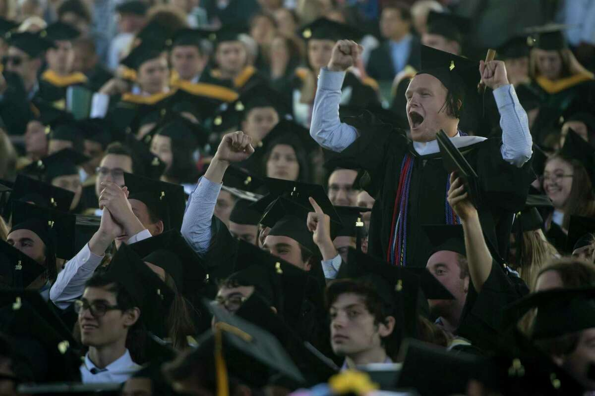 Skidmore College degree recipients cheer on their classmates as they receive their degrees at the 2019 graduation ceremony at Saratoga Performing Arts Center in Saratoga Springs, N.Y. on May 18. (Jenn March, Special to the Times Union)