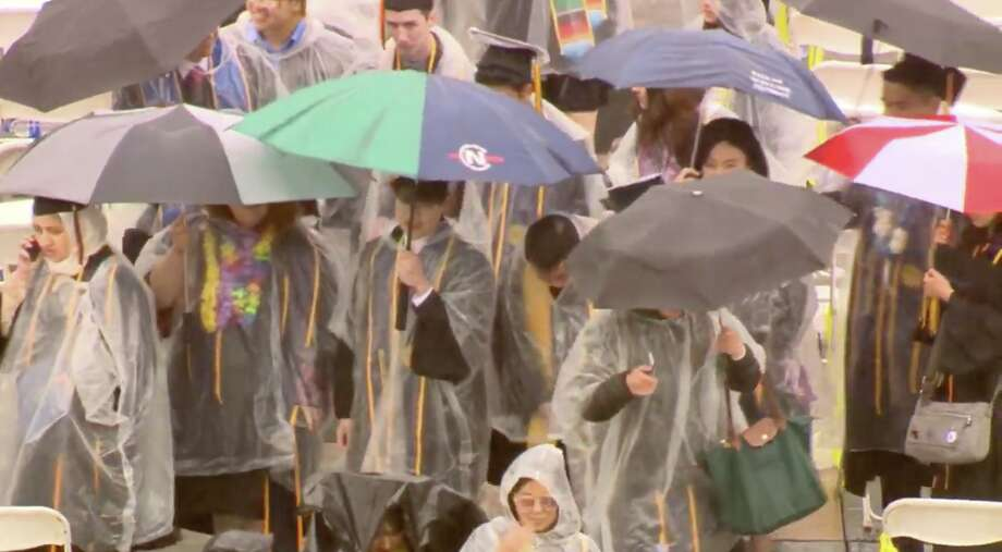 UC Berkeley graduates celebrate in the rain after commencement, as a storm moved through the Bay Area and soaked the crowds at Memorial Stadium in Berkeley. Photo: Screenshot