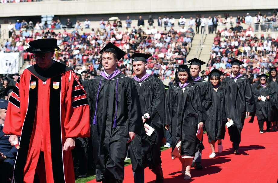 Graduate students walk down the aisle to receive their diplomas during the Rensselaer Polytechnic Institute 213th Commencement on Saturday, May 18, 2019 at RPI's East Athletic Campus in Troy, NY. (Phoebe Sheehan/Times Union) Photo: Phoebe Sheehan, Albany Times Union / 40046971A