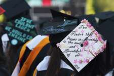 Graduates don their caps with various decorations and quotes during the Rensselaer Polytechnic Institute 213th Commencement on Saturday, May 18, 2019 at RPI's East Athletic Campus in Troy, NY. (Phoebe Sheehan/Times Union)