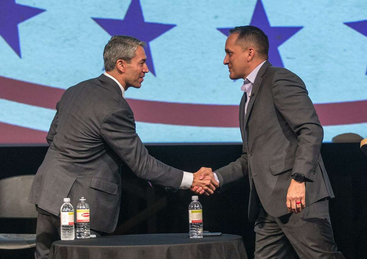 Mayor Ron Nirenberg, left, and Councilman Greg Brockhouse shake hands after participating Tuesday, April 9, 2019 in an AARP-sponsored forum at Palo Alto College.