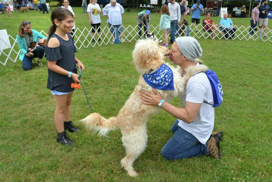 FILE PHOTO: Weston's Michael Bud gets a kiss from Blaze while his daughter Sophie holds the leash after competing in the best tail wagging competition at third annual Westport Dog Festival at Winslow Park on Sunday June 24, 2018 in Westport Conn Photo: Alex Von Kleydorff / Hearst Connecticut Media / Norwalk Hour