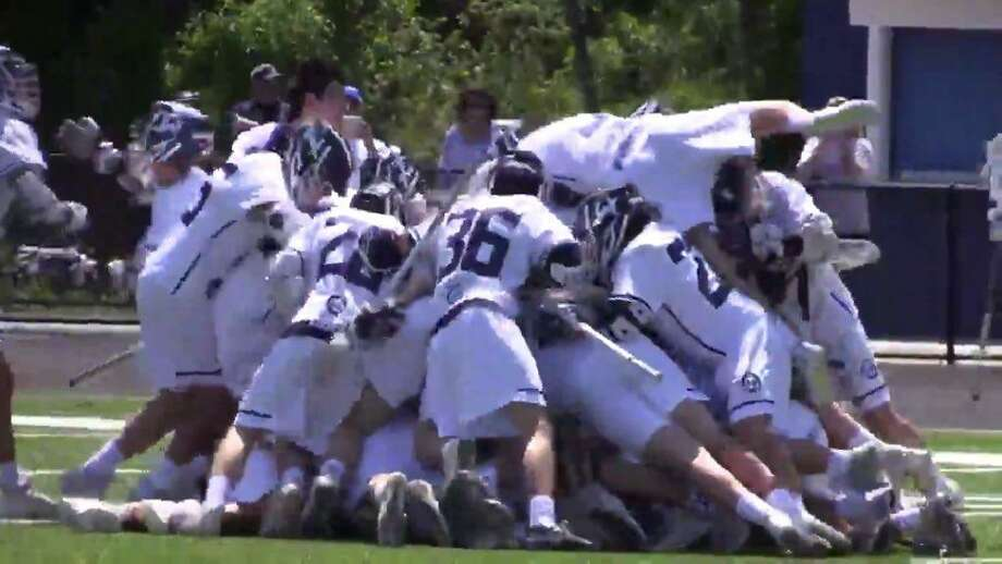 Wilton celebrates its 4-3 overtime win over Staples in the FCIAC boys lacrosse quarterfinals at Fujitani Field in Wilton on May 18, 2019. Photo: Sean Patrick Bowley / Hearst Connecticut Media
