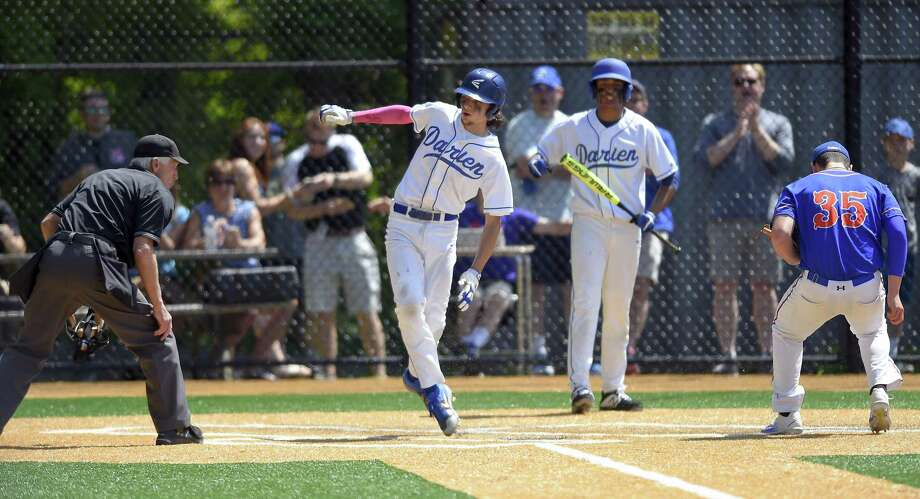 Darien's Devyn Kipphut (2) scores on a wild pitch in the first inning from Danbury pitcher Justin Solimine (35) in a FCIAC quarterfinal baseball game at Darien High School on Saturday, May 18, 2019 in Darien, Connecticut. Darien defeated Danbury 8-2. Photo: Matthew Brown / Hearst Connecticut Media / Stamford Advocate