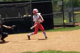 Michelle Morganti of Greenwich hits a single in the Cardinals' 7-0 loss to Trumbull in the FCIAC Girls Softball Tournament quarterfinals in Trumbull on Saturday, May 18, 2019.