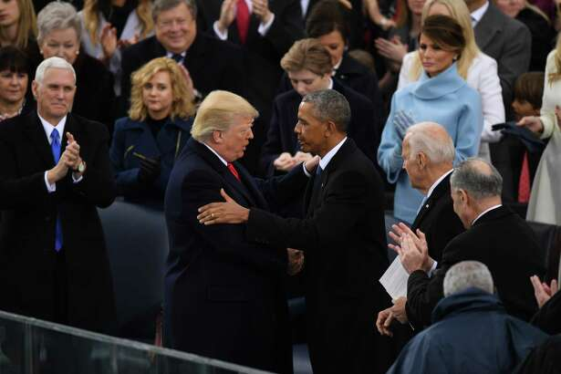 In their own ways, Donald Trump and Barack Obama, above during the former's inauguration, were two of the most unlikely people ever elected to the presidency, raising the question of whether voters in America are using a new lens through which to judge the qualities and qualifications of presidential aspirants.
