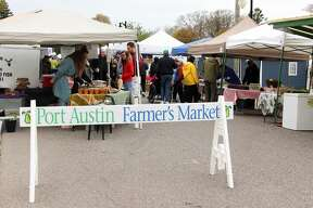 People gather to buy and sell produce, meat and art products at the 2019 Port Austin Farmer's Market. This event was part of the Kickoff to Summer Festival.