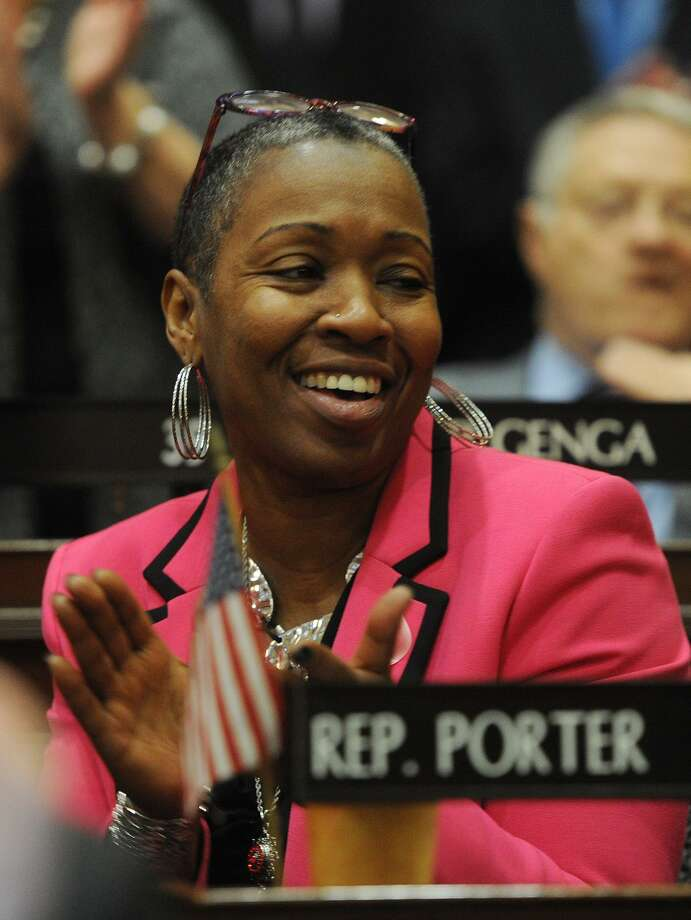 Rep. Robyn Porter, D-New Haven, applauds during the opening session of the state legislature at the Capitol in Hartford, Conn. on Wednesday, February 7, 2018. Porter led the fight for increasing the minimum wage on the House floor. Photo: Brian A. Pounds / Hearst Connecticut Media / Connecticut Post