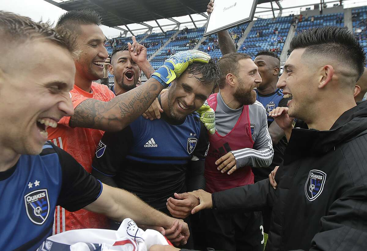 San Jose Earthquakes forward Chris Wondolowski, center, celebrates with teammates after they defeated the Chicago Fire in an MLS soccer match in San Jose, Calif., Saturday, May 18, 2019. Wondolowski scored four times to pass Landon Donovan for most career MLS goals. (AP Photo/Jeff Chiu)
