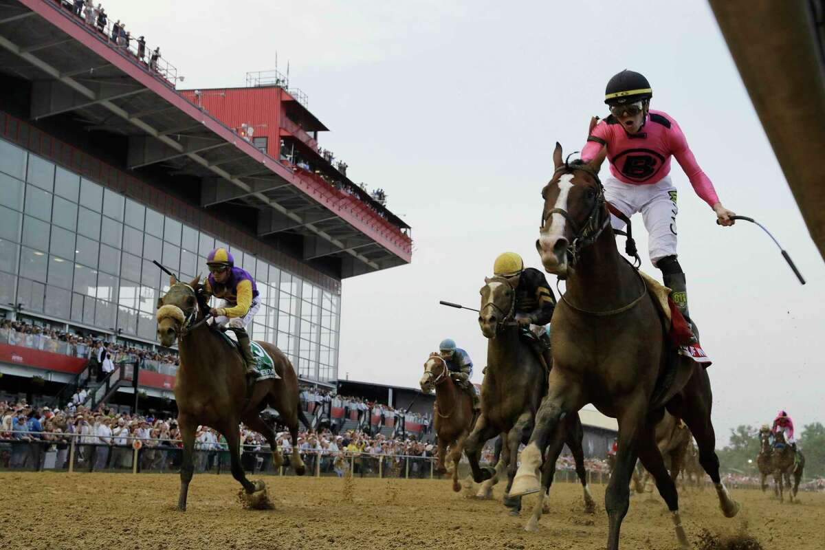 War of Will, ridden by Tyler Gaffalione, right, crosses the finish line first to win the Preakness Stakes horse race at Pimlico Race Course, Saturday, May 18, 2019, in Baltimore.