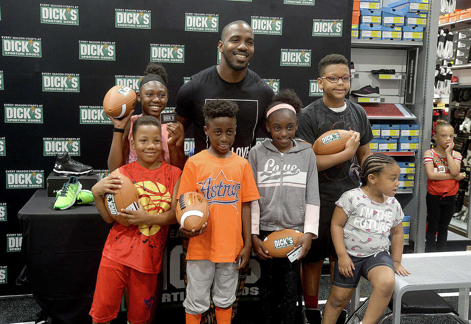 Texans running back Lamar Miller poses with members of the Boys and Girls Club before his public session with fans Saturday at the newly opened Dick's Sporting Goods store in Beaumont. The event was part of the store's grand opening weekend celebration. Photo taken Saturday, May 18, 2019 Kim Brent/The Enterprise Photo: Kim Brent, The Enterprise / BEN