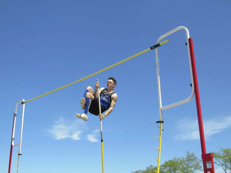 Aiden Oconnor won the pole vault for Lewis Mills at Saturday's Berkshire League Track and Field Championships in Litchfield. Photo: Peter Wallace / For Hearst Connecticut Media