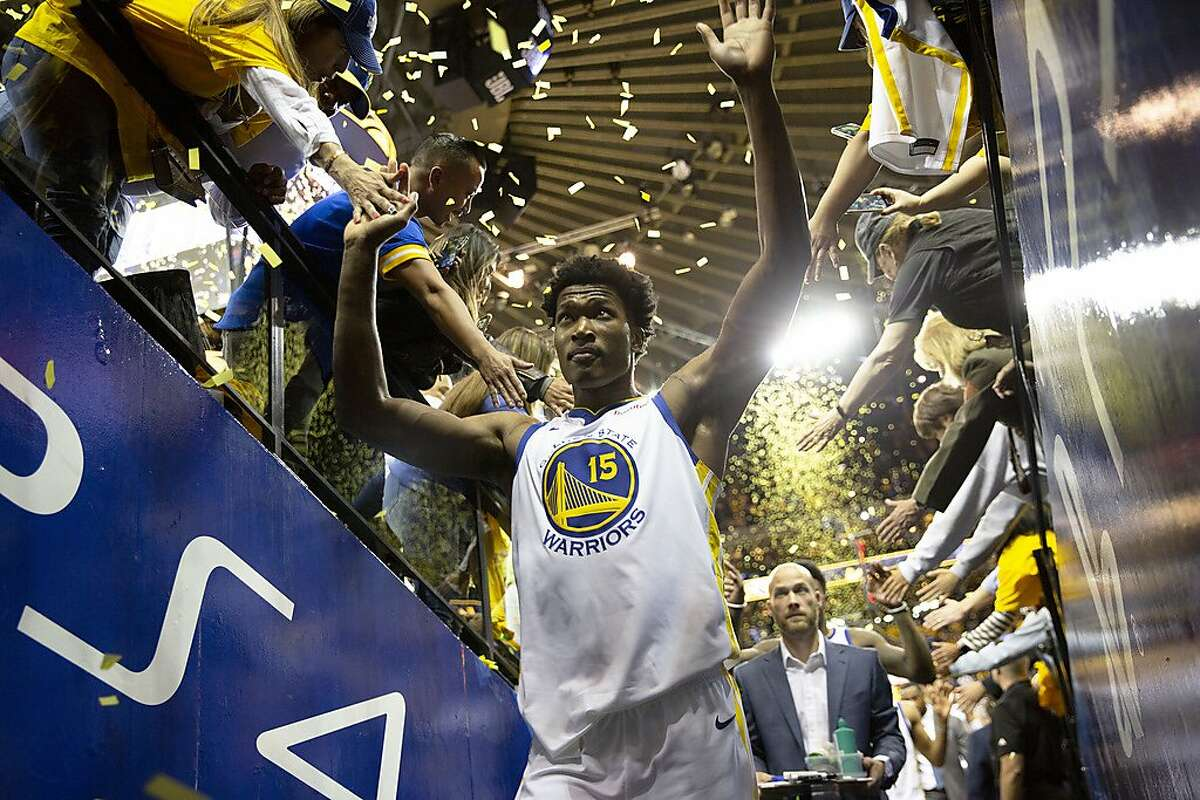 From left: Golden State Warriors Damian Jones greets fans as he exits the court to the locker room following Game 1 of the Western Conference Finals between the Golden State Warriors and the Portland Trailblazers at Oracle Arena on Tuesday, May 14, 2019, in Oakland, Calif.